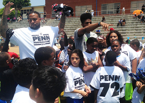 Donald Penn coaching the children